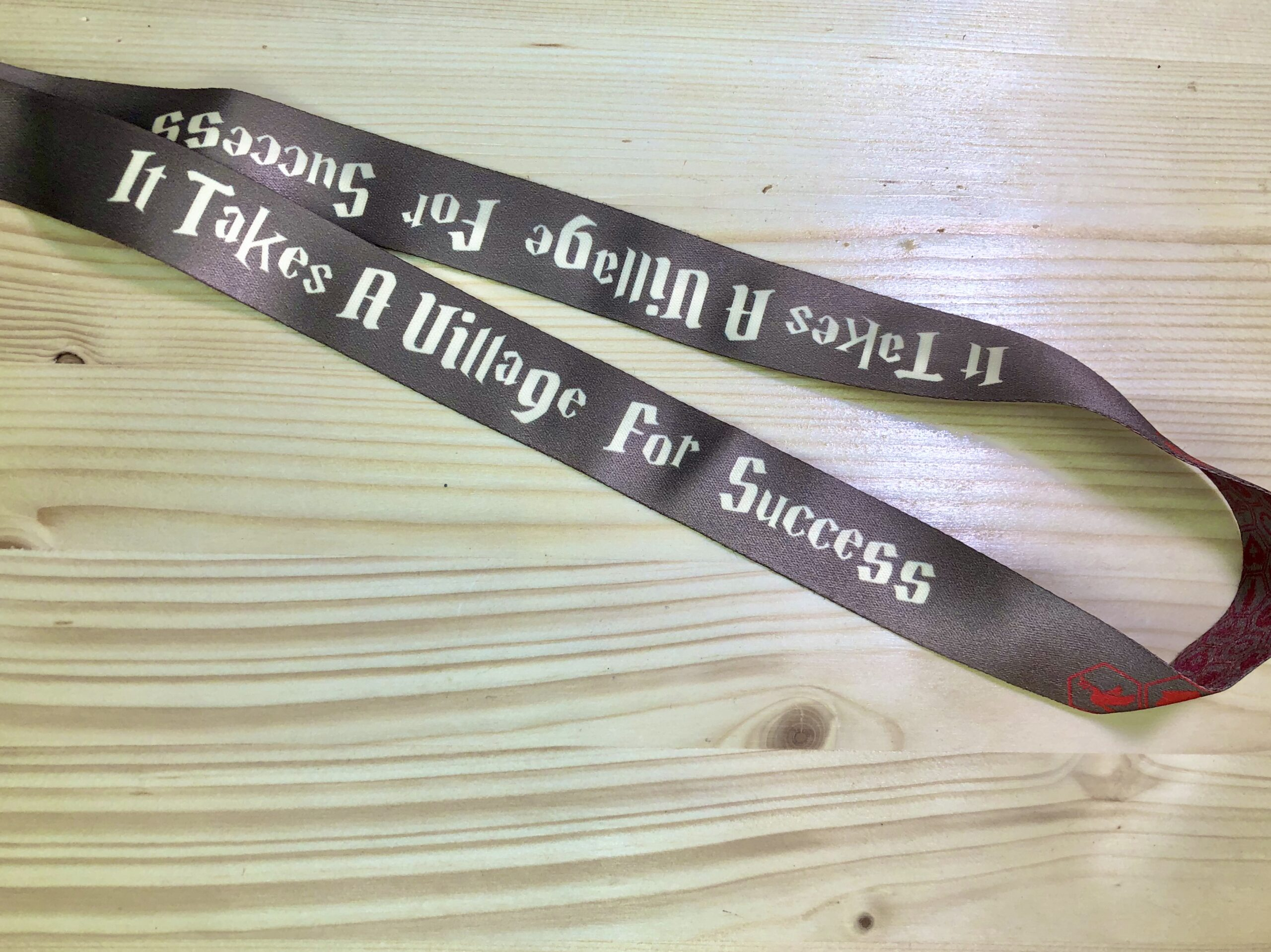 """It Takes A Village For Success"" Lanyard"